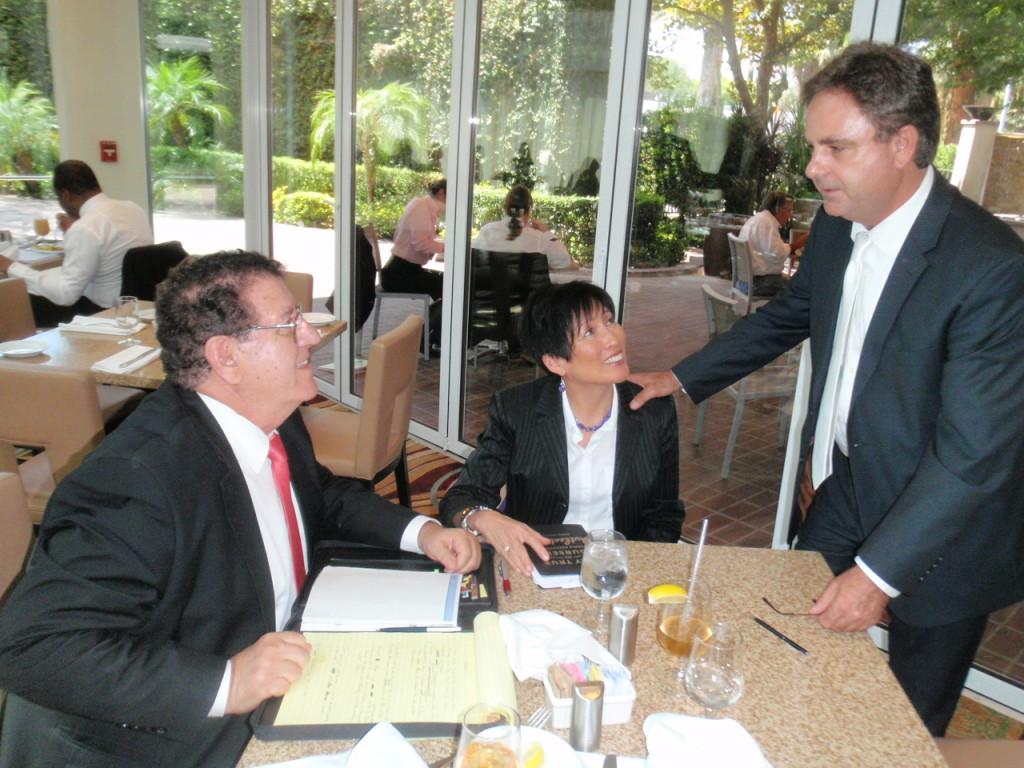 Reggie Discussing BTBI Program with Clients